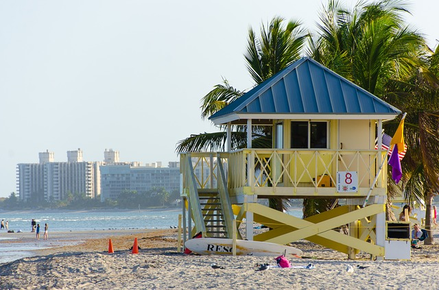 Miami beach scene with colorful lifeguard hut